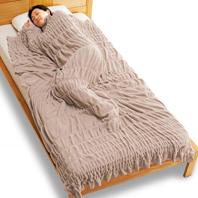 毛布がすっぽりと体を包んでくれる
